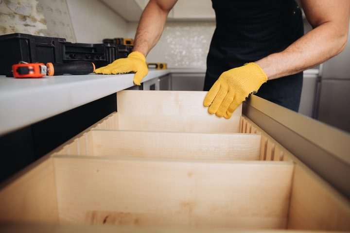 Dividers being installed in a larger kitchen drawer