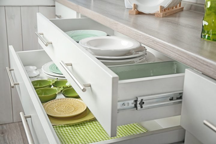 Kitchen drawers with dishes in them