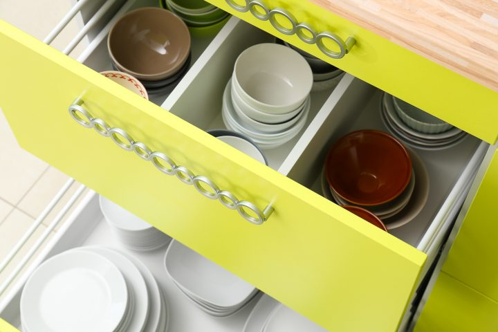Base cabinet drawers organized for dishes ©Africa Studio - stock.adobe.com