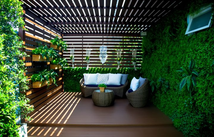 Garden room with vertical plant wall and slatted roof and sides ©Chinnachote - stock.adobe.com