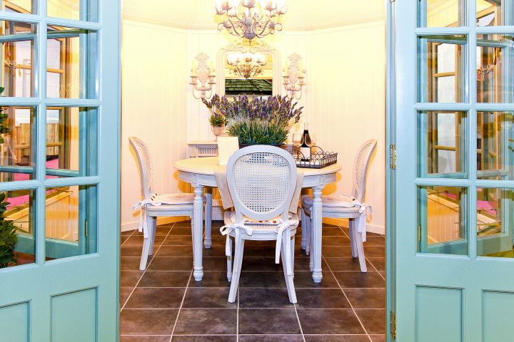 Dining room with fresh flowers and doors leading outside