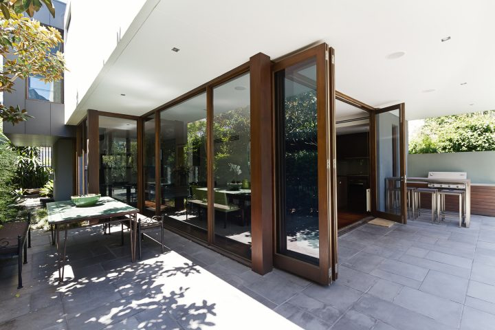 Large glass folding doors leading to a patio ©Jodie Johnson- stock.adobe.com