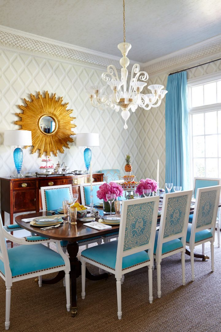 Dining room with a sunburst mirror above the buffet