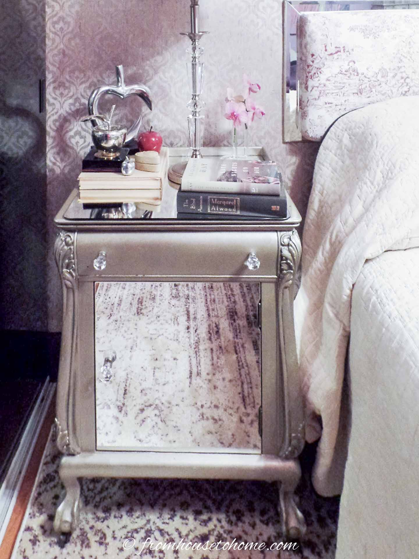 The finished DIY mirrored nightstand beside the bed