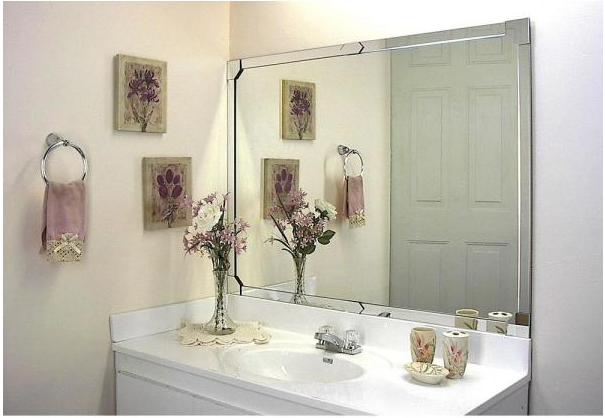 Builder grade mirror trimmed with DIY silver frame from MirrEdge