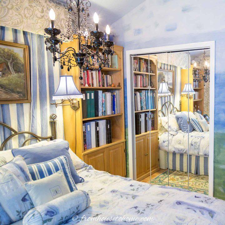 Small bedroom with mirror closet doors
