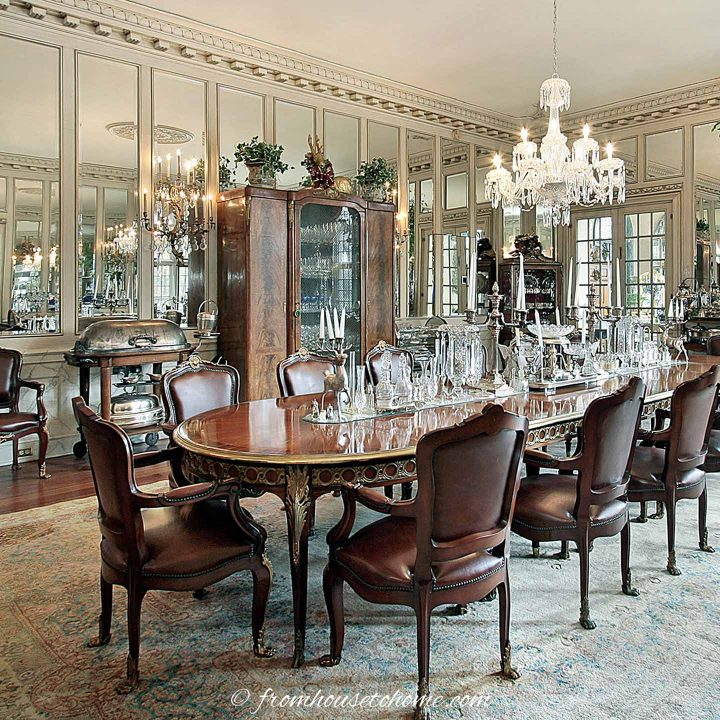 Large dining room with mirror panels on the wall