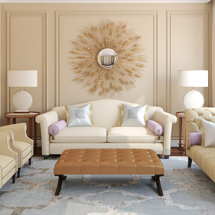 Large gold sunburst mirror hung behind a couch in the living room