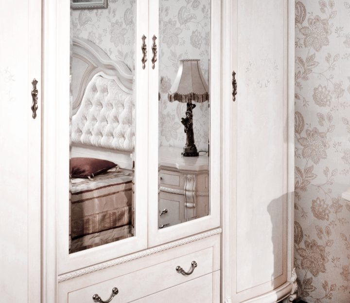 Large armoire with mirror doors in the middle