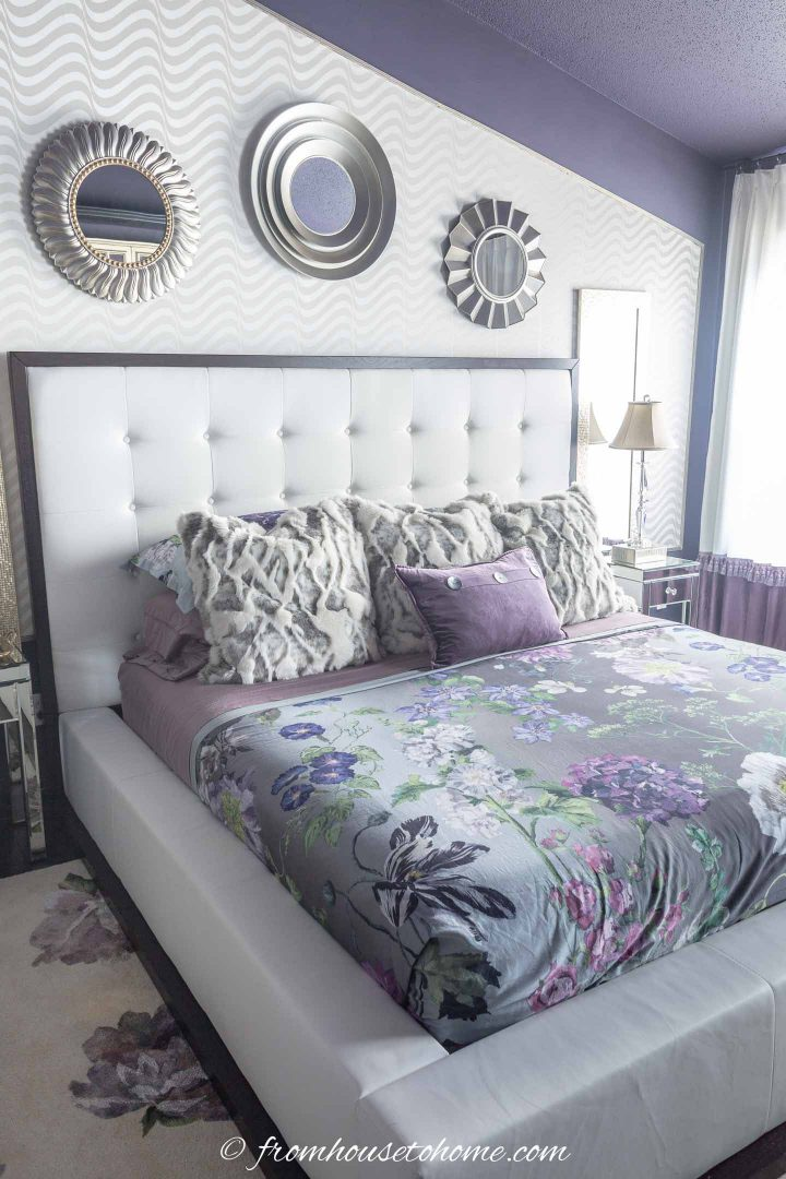 Small round mirrors above the bed