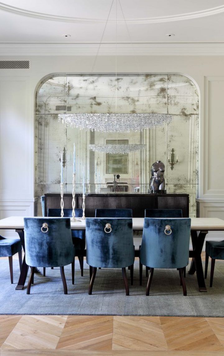 Dining room with antique mirror covering one wall