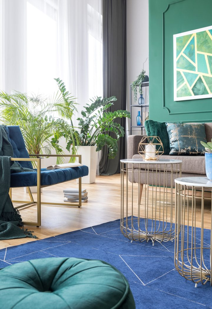 Living room decorated in blue and green with gold accents