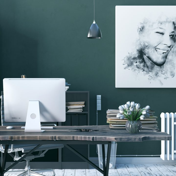 Home office with a live edge desk and dark green walls