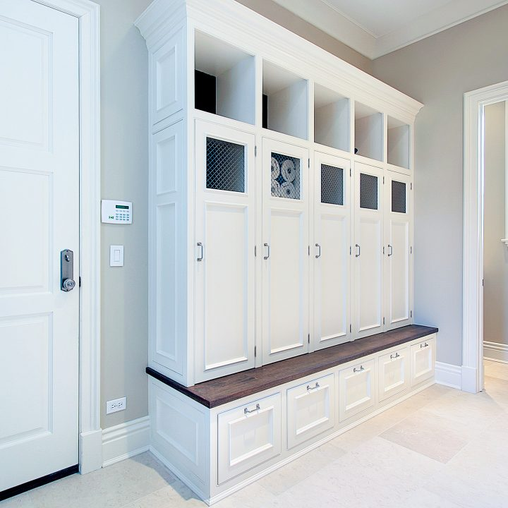Mudroom with white lockers over a long bench