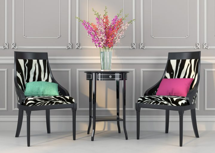 Two chairs with zebra print fabric and black finish