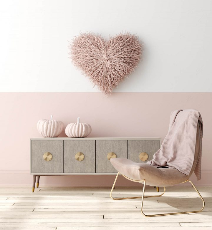 Living room wall with blush pink on the bottom half and white on the top half