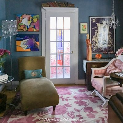 dark living room brightened with a french door and colorful area rug